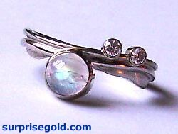 moonstone and two diamonds to one side