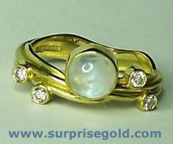 6mm moonstone and four diamonds