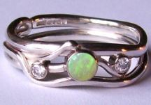 sinuous ring design now set with an opal and two diamonds