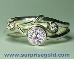 conflict free diamond engagement ring with two smaller diamonds