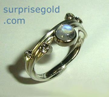 moonstone with four non conflict diamonds