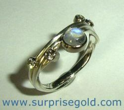 moonstone engagement ring with four diamonds