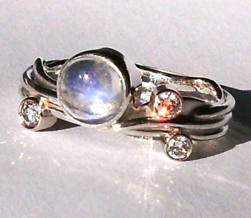 moonstone engagement ring with three diamonds