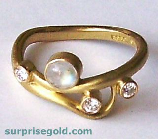 moonstone and diamond ring in matt yellow gold