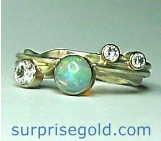 diamond and opal engagement ring