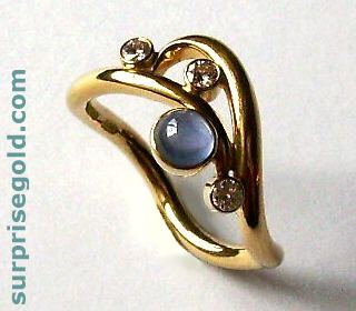 sapphire and diamond curl ring