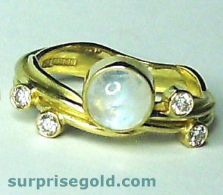diamond and moonstone engagement ring in yellow gold